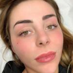 Courtney Black Lip Tattoo
